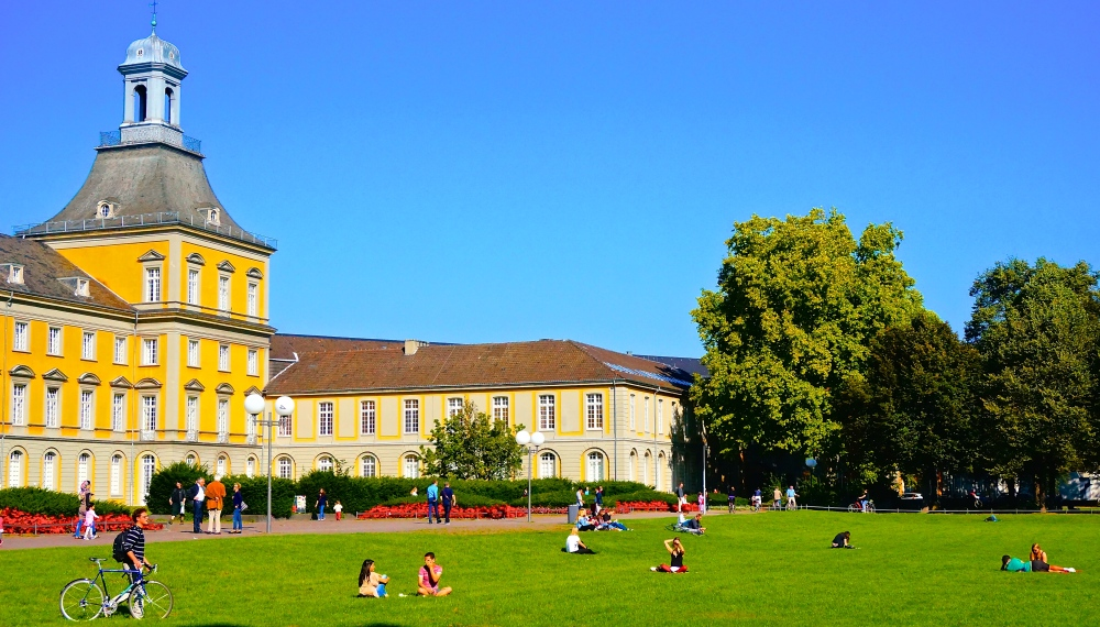 Long weekends and the sun up means sleeping and playing in grass is the way to go. University of Bonn.